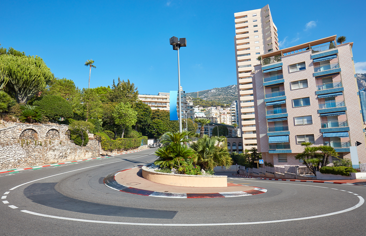 Monte Carlo street curve with formula one red and white sign on a sunny summers day in Monte Carlo, Monaco