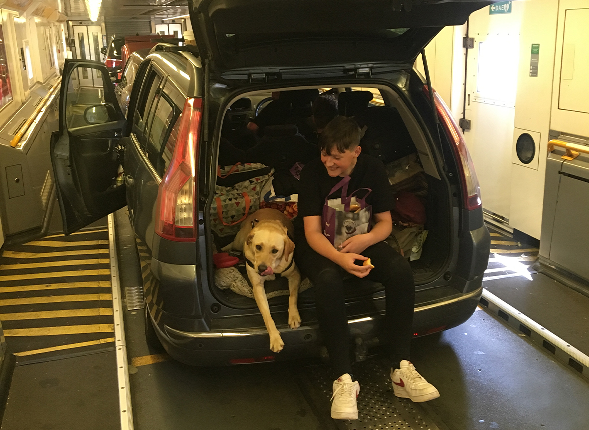 Boy and dog, in the back of the car on board a Eurotunnel shuttle