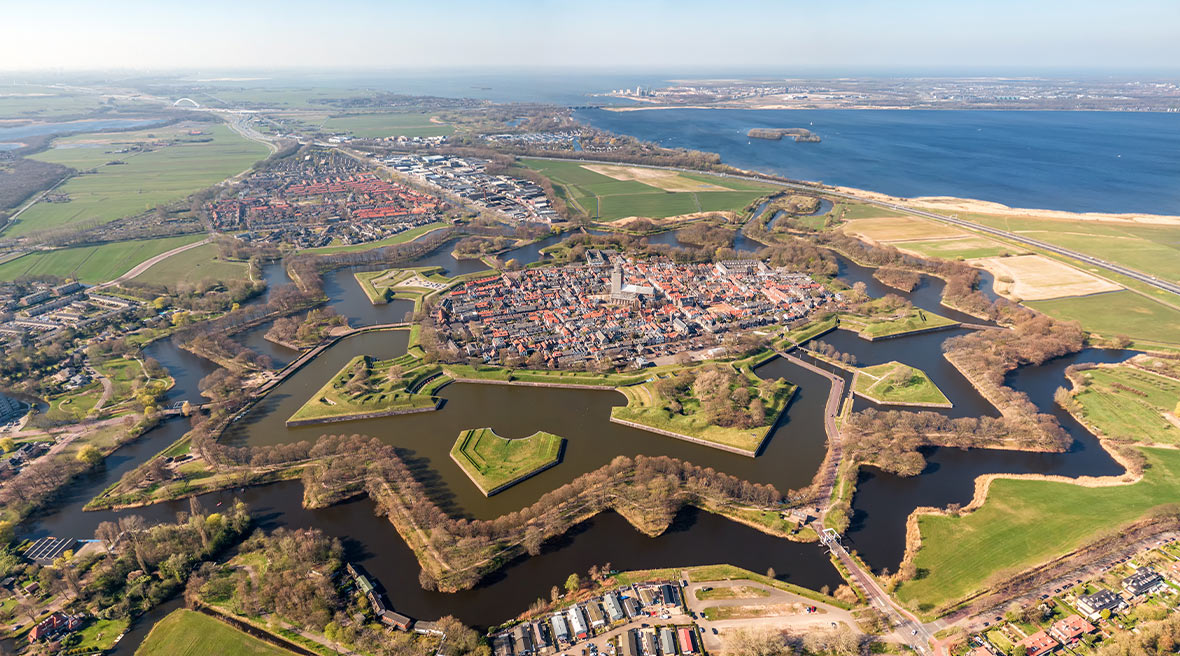 Aerial image of the star shaped medieval Naarden Fortress village in the Netherlands with defence walls and canals