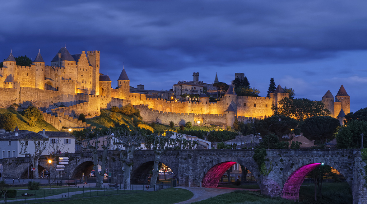 Carcassonne's walled city is proudly illuminated during the evening