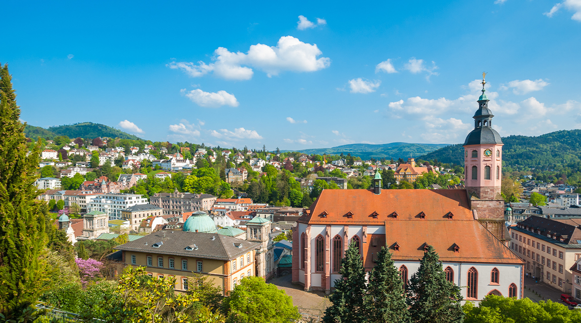 Panoramic view of the Baden-Baden village with historic townhouses and church surrounded by beautiful greenery and landscapes