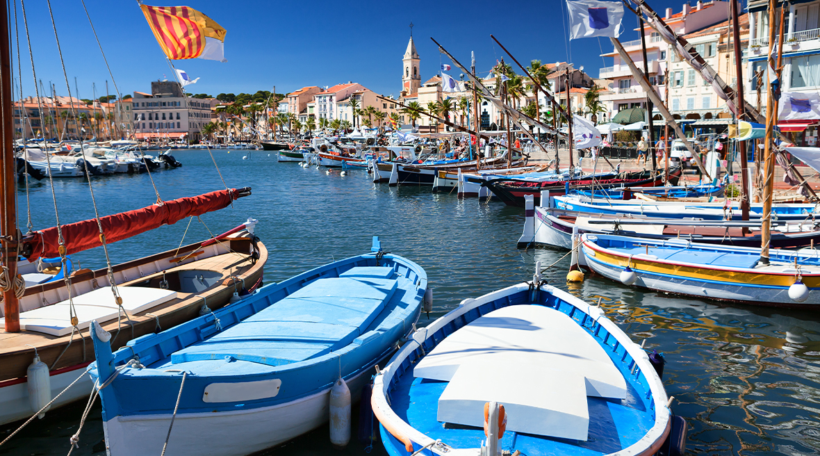 boats in the harbour on sunny blue waters