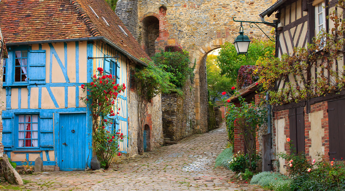 Cobbled streets, timbered house and brick archway a picturesque French village