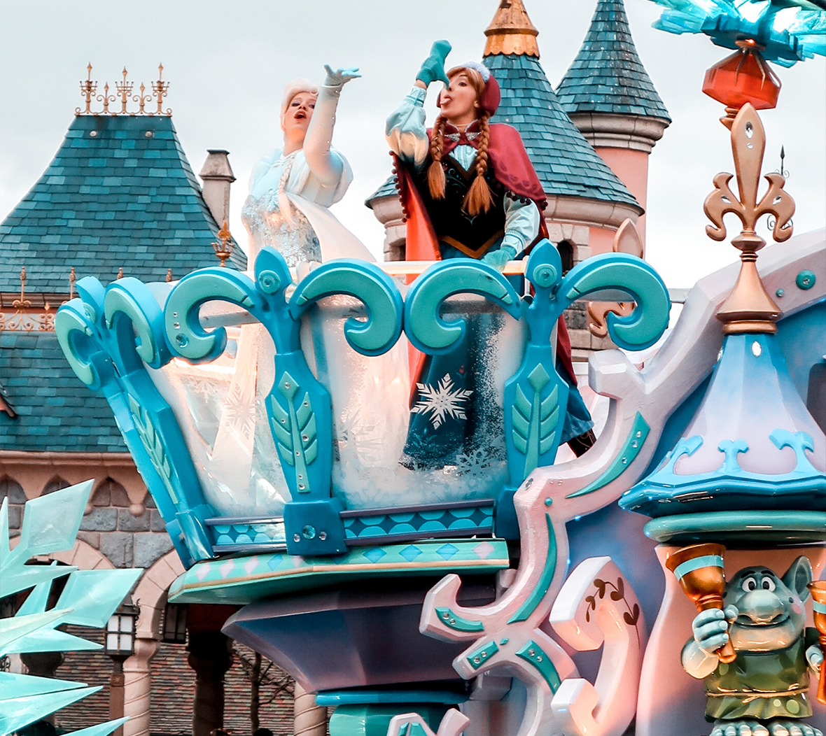 Disney's Elsa and Anna from Frozen on a carnival float in a Disneyland Paris parade