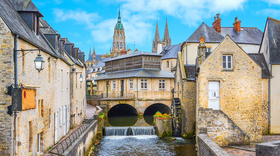 Picturesque French village with bridge over river