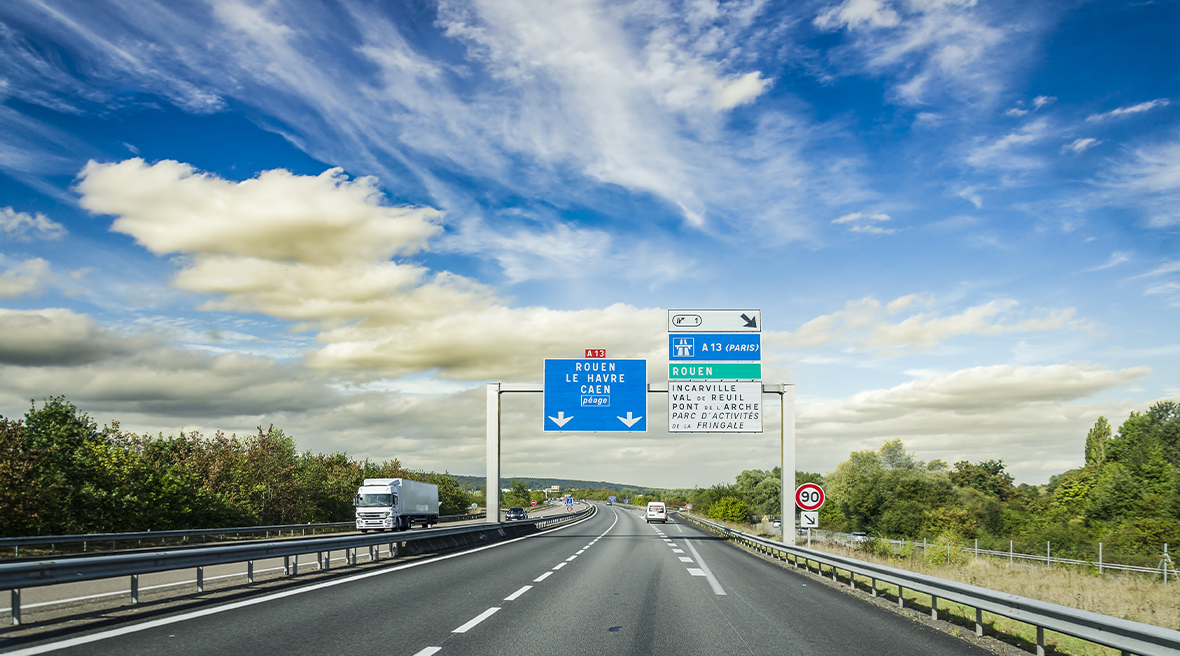 view of a motorway in France with road signs and speed markings