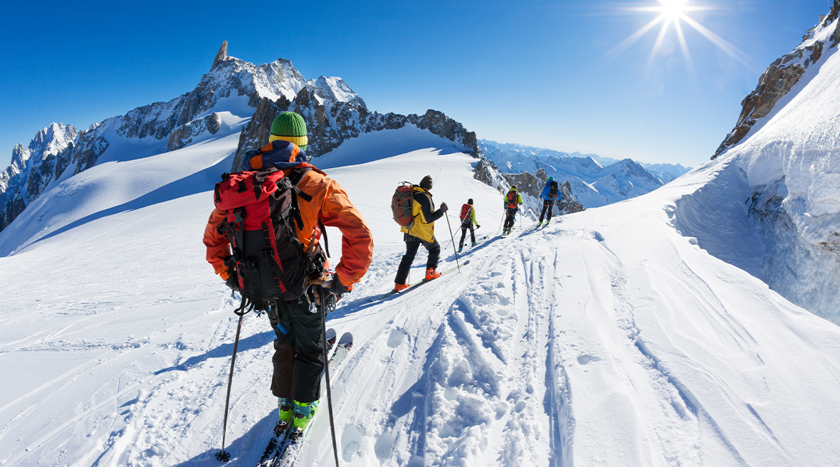 A group of skiers start the descent of Vallée Blanche, Mont Blanc Massif, Chamonix, France