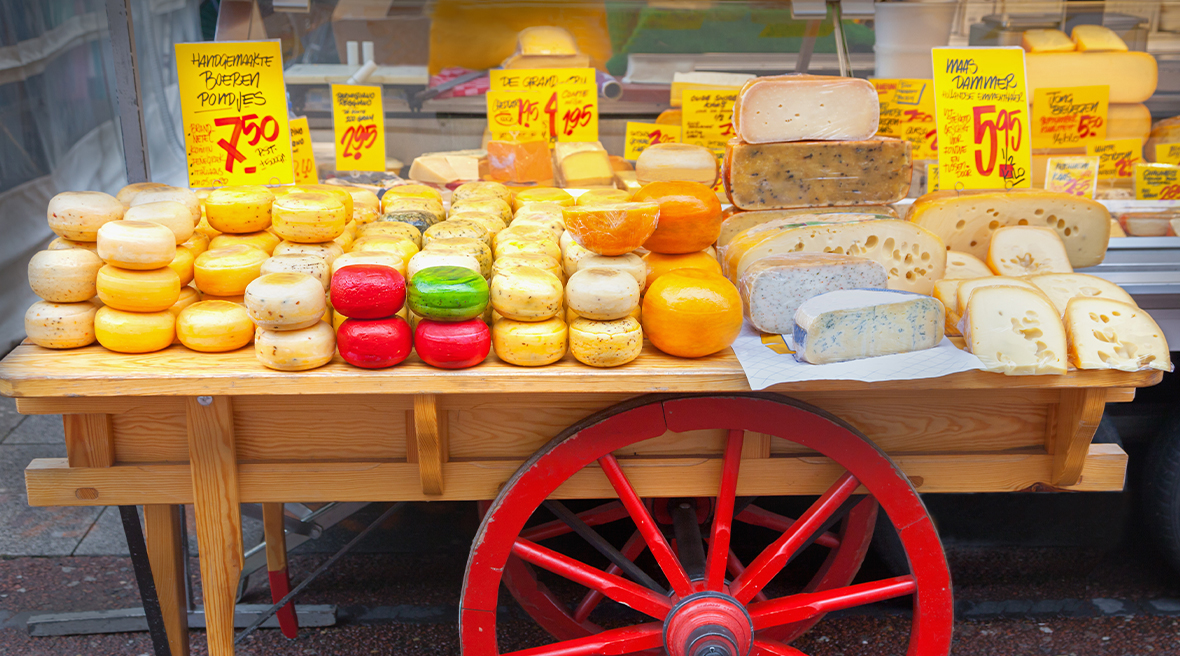 Dutch cheese on top of a table with a wheel in a market