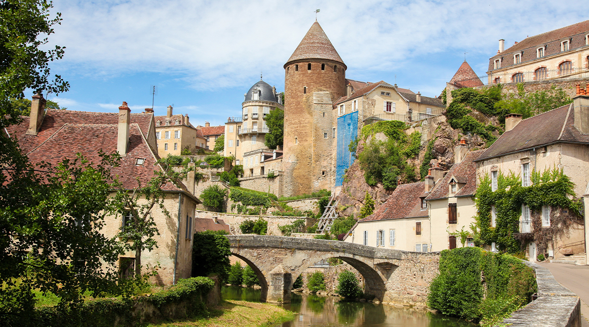 Picturesque French town with bridge over river