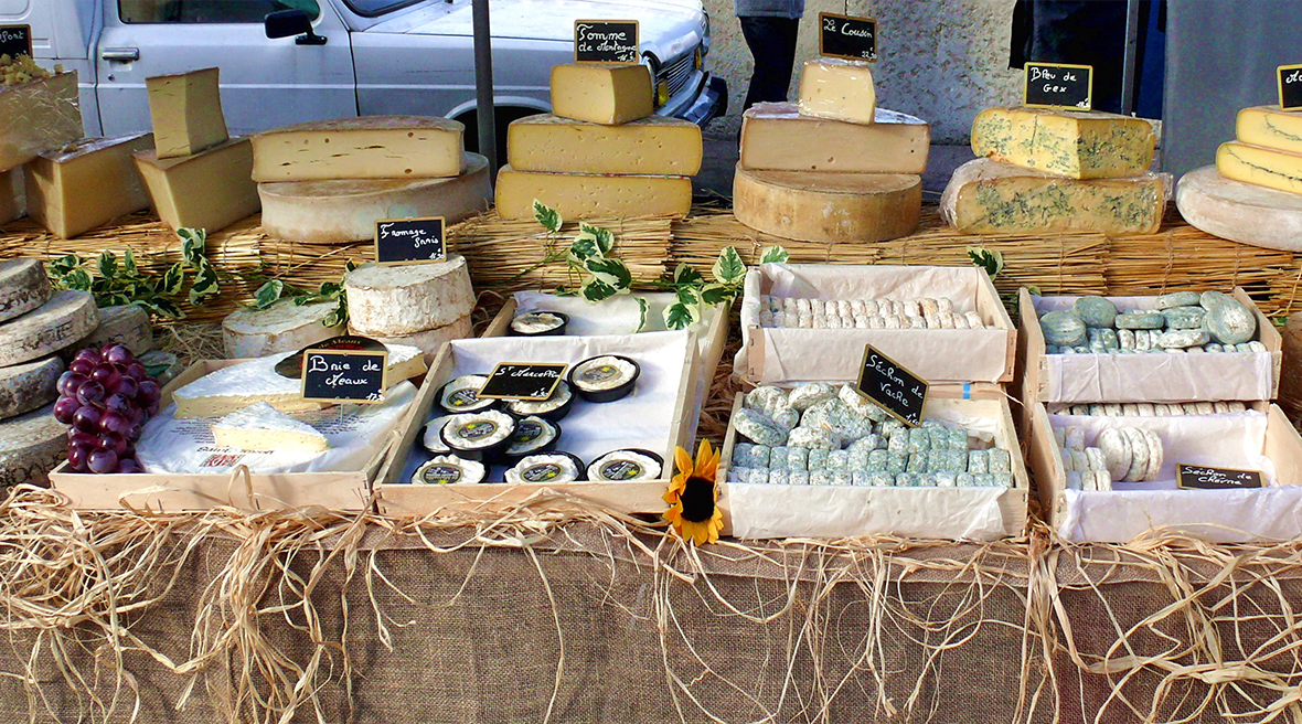 Display of different cheeses at the Lyon Market, France