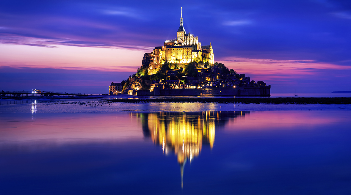 View of Le Mont Saint-Michel island illuminated at dusk