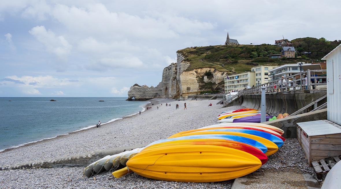 Colourful kayaks on the pebble beach at Étretat