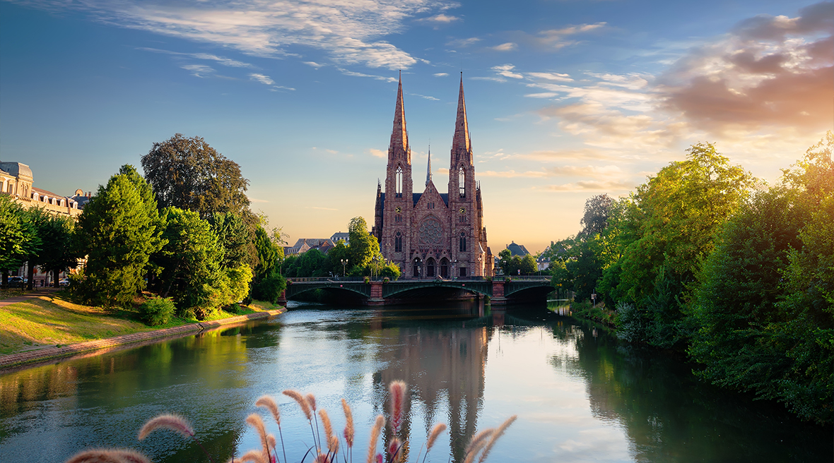 Strasbourg church overlooking river and foliage