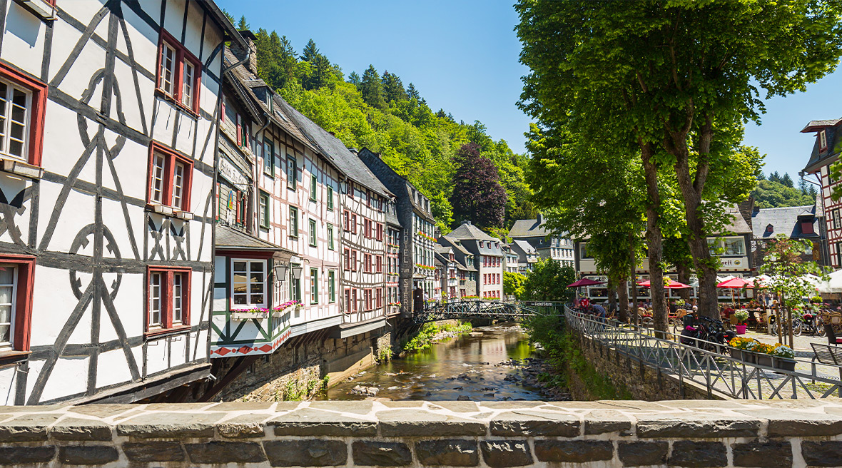 Monschau's cobbled streets, surrounded by colourful timber-framed houses and shops