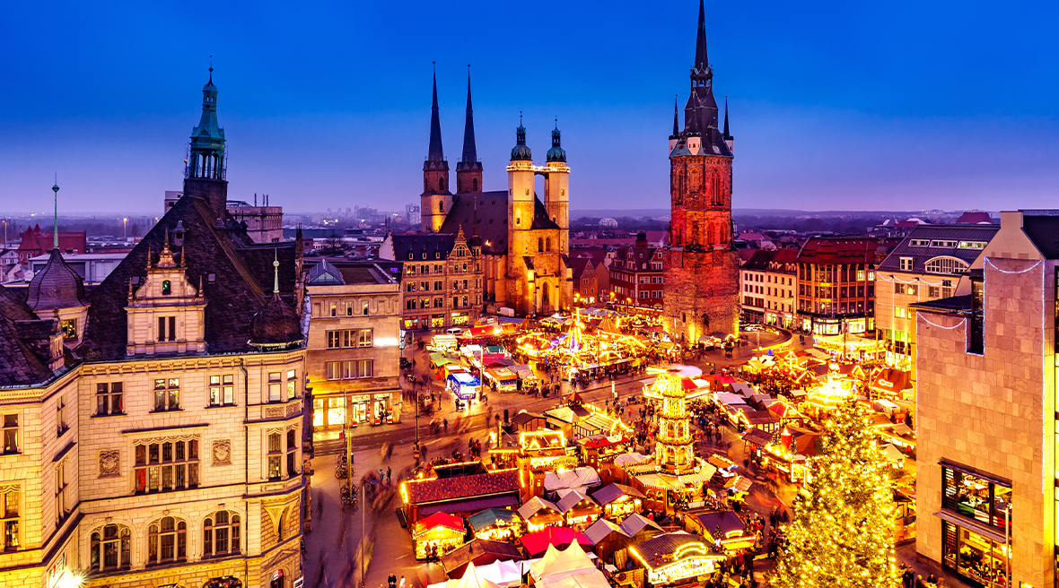 Stunning lit up town with Christmas market surrounded by picturesque architecture