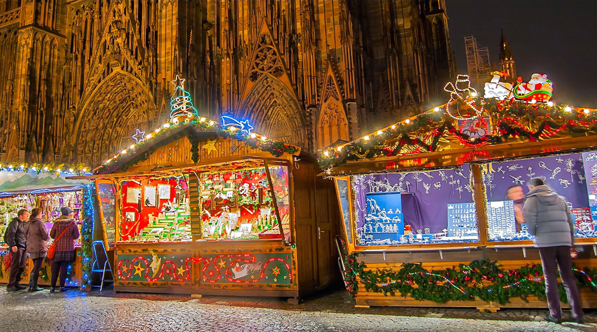 festively decorated Christmas market stalls outside Strasbourg Cathedral