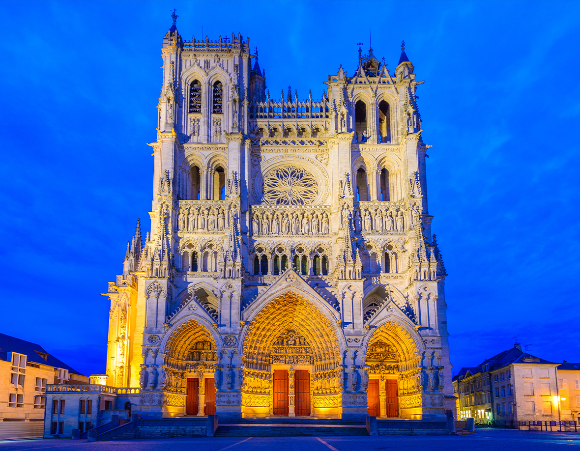 Amiens large gothic cathedral at night lit up with lights