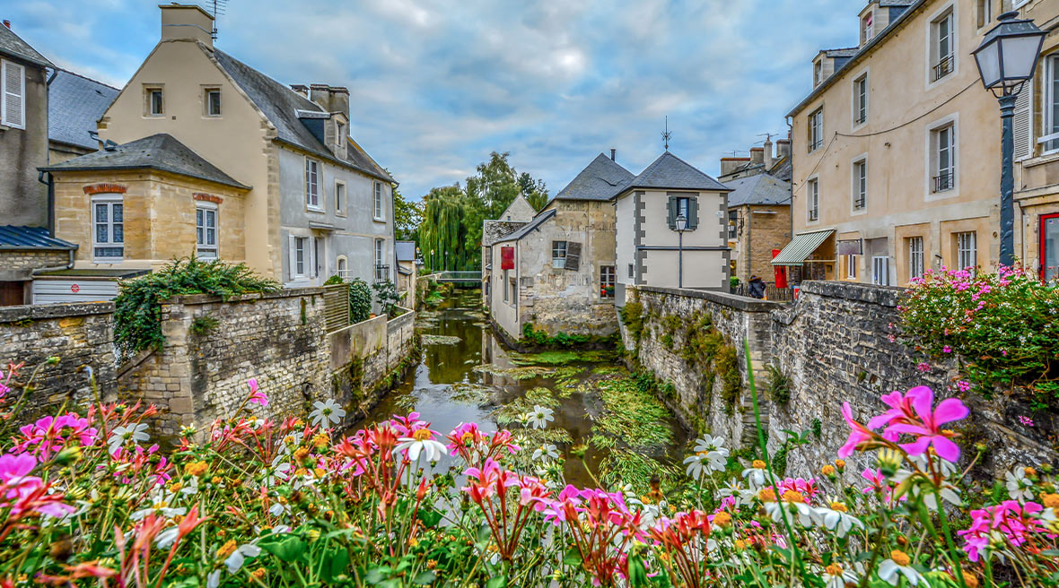 The picturesque French town of Bayeux France near the coast of Normandy with its medieval houses overlooking the River Aure on an overcast day