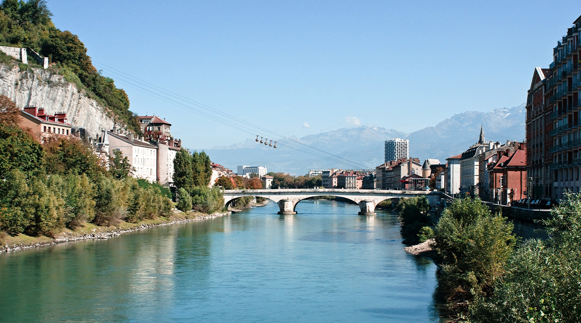 Grenoble Bridge overlooking the beautiful French town and cliffs