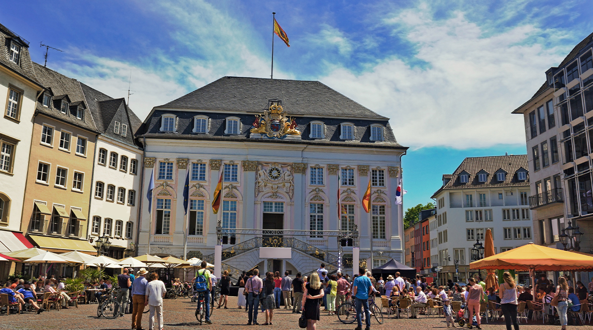 crowd of people gathered outside of the Old Town Hall in Bonn